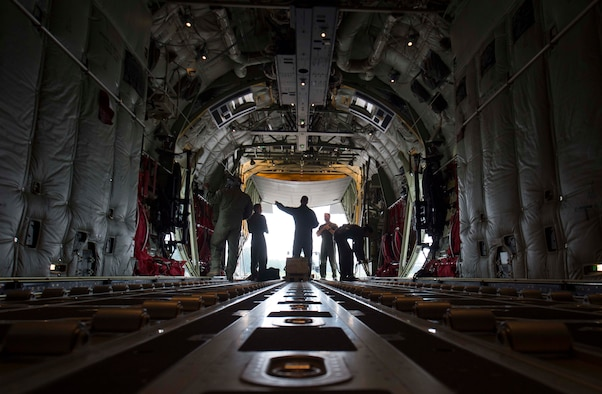 Loadmasters assigned to the 37th Airlift Squadron stand in the back of a C-130J Super Hercules aircraft on Ramstein Air Base, Germany, June 12, 2018. Aircraft loadmasters are responsible for properly loading, securing, and escorting cargo and passengers. (U.S. Air Force photo by Senior Airman Elizabeth Baker)