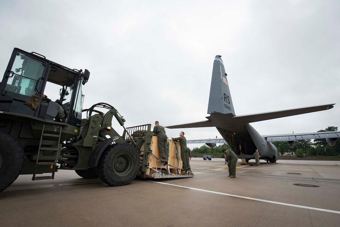 Loadmasters assigned to the 37th Airlift Squadron inspect cargo to be loaded onto a C-130J Super Hercules aircraft on Ramstein Air Base, Germany, June 12, 2018. Ramstein's loadmasters calculate the center of gravity on the aircraft and arrange cargo by weight to ensure the aircraft remains properly balanced even after adding up to 41,790 pounds. (U.S. Air Force photo by Senior Airman Elizabeth Baker)