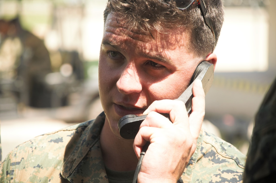 U.S. Marine Cpl. Tyler Slaggert, a field radio operator with Special Purpose Marine Air-Ground Task Force - Southern Command, performs radio checks with soldiers from Joint Task Force - Bravo's 1st Battalion, 228th Aviation Regiment during a communications exercise aboard Soto Cano Air Base, Honduras, to prepare for future joint-level operations, June 19, 2018. The Marines and sailors of SPMAGTF-SC are conducting security cooperation training and engineering projects alongside partner nation military forces in Central and South America. The unit is also on standby to provide humanitarian assistance and disaster relief in the event of a hurricane or other emergency in the region.