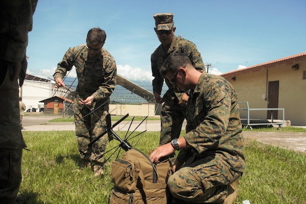 Marines with Special Purpose Marine Air-Ground Task Force - Southern Command's communications section prepare to sync their equipment with that of their counterparts in Joint Task Force - Bravo's 1st Battalion, 228th Aviation Regiment's communications section during a communications exercise aboard Soto Cano Air Base, Honduras, to prepare for future joint-level operations, June 19, 2018. The Marines and sailors of SPMAGTF-SC are conducting security cooperation training and engineering projects alongside partner nation military forces in Central and South America. The unit is also on standby to provide humanitarian assistance and disaster relief in the event of a hurricane or other emergency in the region.