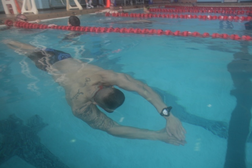 A soldier swims during training.