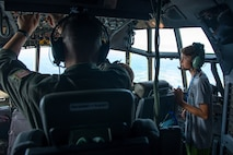 A participant in the Minnesota Aviation Career Education Camp watches the various tasks being performed throughout the cockpit of a C-130 June 14, 2018. Students had the opportunity to see first-hand flight operations involved with flying a C-130 at the 934th Airlift Wing. (U.S. Air Force photo by Master Sgt. Eric Amidon)