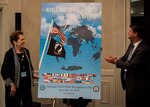 The 2018 National POW/MIA Recognition Day poster is revealed during the Annual National League of Families meeting in Crystal City, Virginia, June 21, 2018.  The poster was unveiled by Ann-Mills Griffiths, Chairman of the Board and CEO of the National League of POW/MIA Families, left, and Randall G. Schriver, Assistant Secretary of Defense for Asian and Pacific Security.  (U.S. Marine Corps photo by Sgt. Lauren Gramley)