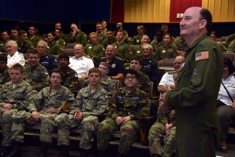 Col. Thomas K. Smith Jr., 433rd Airlift Wing commander, describes the Alamo Wing's mission to cadets of the Air Force Academy and Civil Air Patrol at Joint Base San Antonio-Lackland, Texas, June 8, 2018. The cadets and their chaperones caught a flight onboard a C-5M Super Galaxy aircraft, which is used to provide airlift support for peacetime, contingency and humanitarian operations. (U.S. Air Force photo by Staff Sgt. Lauren M. Snyder)