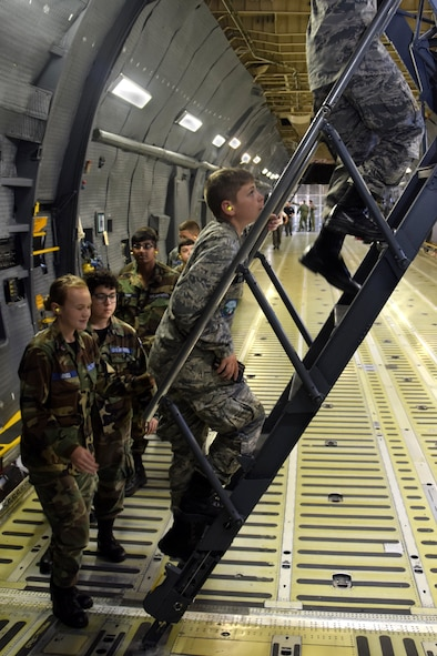 U.S. Air Force Civil Air Patrol cadets climb the rear section's stairs to the 433rd Airlift Wing C-5M Super Galaxy aircraft's upper deck at Joint Base San Antonio-Lackland, Texas, June 8, 2018. Members of the official Air Force auxiliary fly nearly 100,000 hours per year performing disaster relief, counterdrug, search and rescue, fighter interceptor training, aerial observation and cadet orientation flights. (U.S. Air Force photo by Staff Sgt. Lauren M. Snyder)