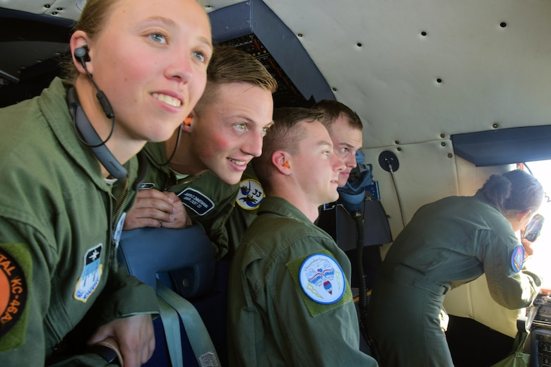 U.S. Air Force Academy cadets peer through the windshield of a C-5M Super Galaxy aircraft during an incentive flight from Joint Base San Antonio-Lackland, Texas, June 8, 2018. As a C-5M unit, the 433rd Airlift Wing stands ready to provide combat ready airlift and many other types of missions around the globe on a moment's notice. (U.S. Air Force photo by Staff Sgt. Lauren M. Snyder)