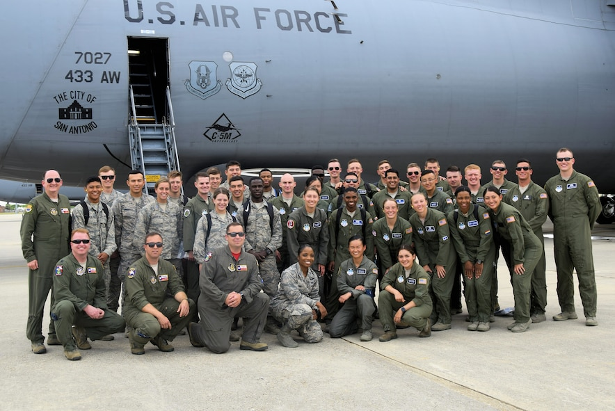 U.S. Air Force Academy cadets pose with Col. Thomas K. Smith Jr. (far left), 433rd Airlift Wing commander, and the Reserve Citizen Airmen aircrew of the C-5M Super Galaxy aircraft after an incentive flight from Joint Base San Antonio-Lackland, Texas, June 8, 2018. With the C-5M, the Alamo Wing provides massive strategic airlift for deployment and supply of combat and support forces worldwide. (U.S. Air Force photo by Staff Sgt. Lauren M. Snyder)