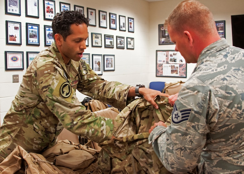Tech. Sgt. Gabriel Ortiz, a 919th Special Operations Security Forces Squadron cadre member, instructs a fellow squadron member on the most efficient techniques for packing a rucksack