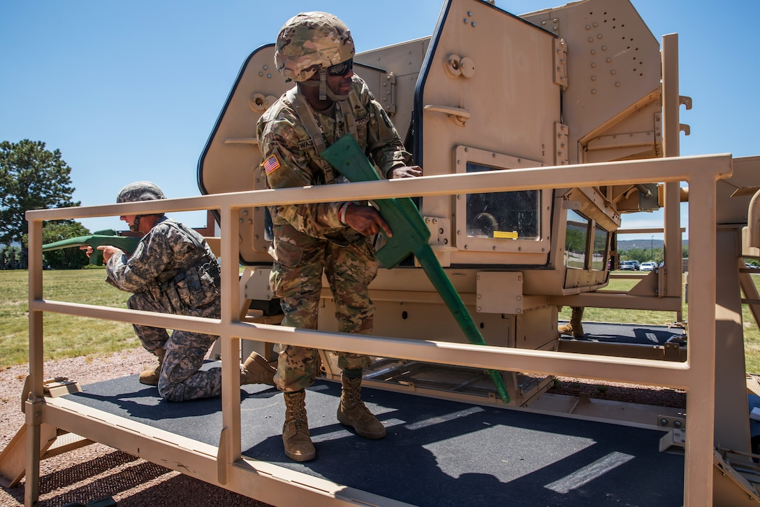 Soldiers organize the High Mobility Multipurpose Wheeled Vehicle Egress Assistance Training as part of Golden Coyote.