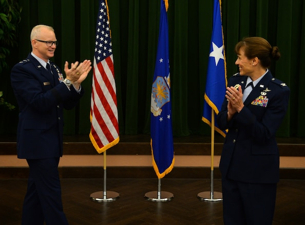Maj. Gen. Chris Weggeman, Air Forces Cyber commander, congratulates Col. Melissa Cunningham, new 67th Cyberspace Wing commander, during the wing's change of command ceremony at Joint Base San Antonio-Lackland, Texas, June 20, 2018. Col. Bradley Pyburn relinquished command of the wing to Cunningham. (U.S. Air Force photo by Tech. Sgt. R.J. Biermann)