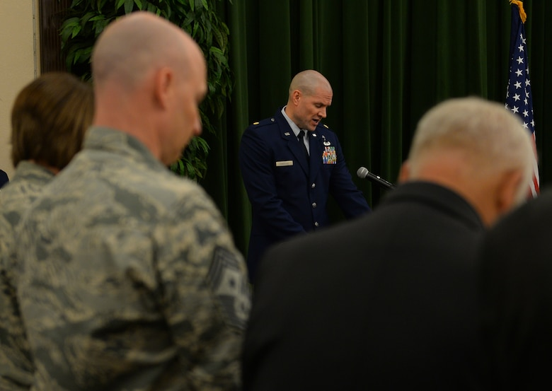 Chaplain (Maj.) Craig Forsythe, 67th Cyberspace Wing, provides the invocation during the wing's change of command ceremony at Joint Base San Antonio-Lackland, Texas, June 20, 2018. Col. Bradley Pyburn relinquished command of the wing to Col. Melissa Cunningham during the ceremony. (U.S. Air Force photo by Tech. Sgt. R.J. Biermann)