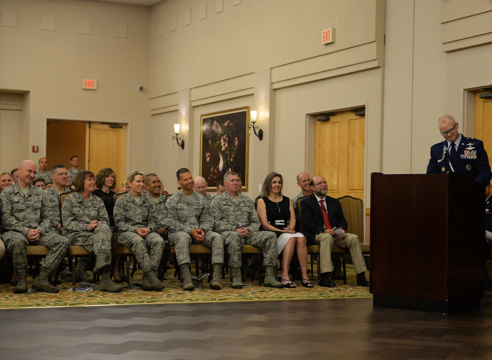 Maj. Gen. Chris Weggeman, Air Forces Cyber commander, speaks to the audience during the 67th Cyberspace Wing change of command ceremony at Joint Base San Antonio-Lackland, Texas, June 20, 2018. Weggeman presided over the ceremony, where Col. Bradley Pyburn relinquished command of the wing to Col. Melissa Cunningham. (U.S. Air Force photo by Tech. Sgt. R.J. Biermann)