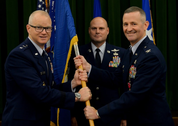 Maj. Gen. Chris Weggeman, Air Forces Cyber commander, accepts the 67th Cyberspace Wing guidon from Col. Bradley Pyburn, 67th Cyberspace Wing commander, during the wing's change of command ceremony at Joint Base San Antonio-Lackland, Texas, June 20, 2018. Pyburn relinquished command of the wing to Col. Melissa Cunningham. (U.S. Air Force photo by Tech. Sgt. R.J. Biermann)