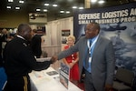 Defense Logistics Agency Director Army Lt. Gen. Darrell K. Williams greets members of the DLA Land and Maritime Small Business Office Earl Madison and Ami Banks during a visit to the exhibition hall June 19 shortly after his keynote address to kick off the 2018 DLA Land and Maritime Supplier Conference and Exposition in downtown Columbus, Ohio. The exposition featured more than 70 exhibitor booths representing organizations that produce or supply equipment or services to support the Warfighter on both land and at sea.