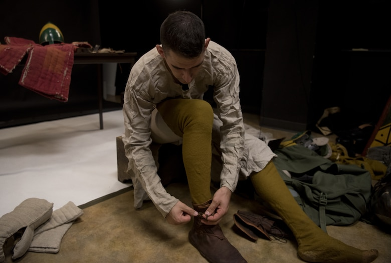 U.S. Air Force Senior Airman Benjamin Lanteigne, 628th Security Forces Squadron patrolman, tries on a shoe he created as a part of his medieval battle gear June 14, 2018.