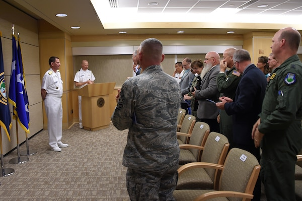 U.S. Navy Vice Adm. Dave Kriete (left), deputy commander of U.S. Strategic Command (USSTRATCOM), receives a standing ovation during his promotion ceremony at Offutt Air Force Base, Neb., June 15, 2018. Following his promotion, Kriete replaced Vice Adm. Charles Richard as USSTRATCOM deputy commander. He previously served as the National Security Council director of strategic capabilities policy. U.S. Strategic Command has global responsibilities assigned through the Unified Command Plan that include strategic deterrence, nuclear operations, space operations, joint electromagnetic spectrum operations, global strike, missile defense, and analysis and targeting.