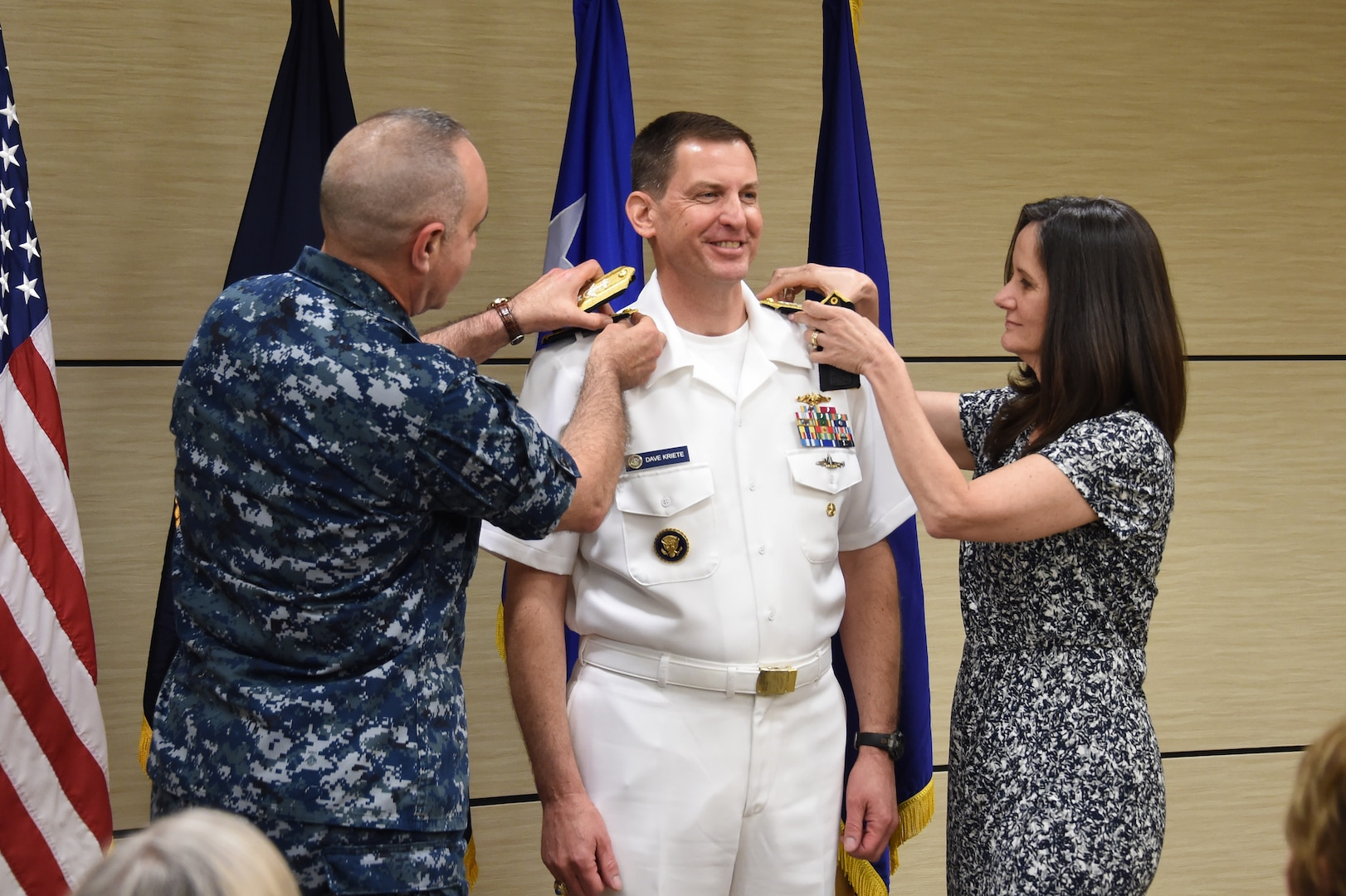 U.S. Navy Vice Adm. Dave Kriete (center), incoming deputy commander of U.S. Strategic Command (USSTRATCOM), receives his new rank insignia from his wife Kathleen (right) and Vice Adm. Charles Richard, outgoing USSTRATCOM deputy commander, during a ceremony at Offutt Air Force Base, Neb., June 15, 2018. Following his promotion, Kriete replaced Richard as USSTRATCOM deputy commander. He previously served as the National Security Council director of strategic capabilities policy. U.S. Strategic Command has global responsibilities assigned through the Unified Command Plan that include strategic deterrence, nuclear operations, space operations, joint electromagnetic spectrum operations, global strike, missile defense, and analysis and targeting.