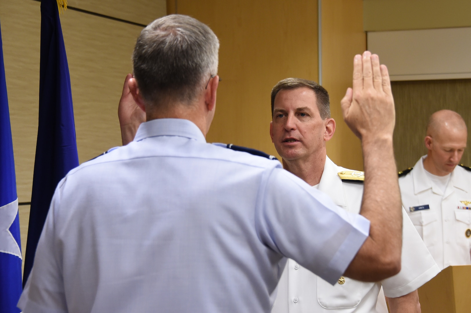 U.S. Navy Vice Adm. Dave Kriete (center), deputy commander of U.S. Strategic Command (USSTRATCOM), recites the oath of office during his promotion ceremony at Offutt Air Force Base, Neb., June 15, 2018. U.S. Air Force Gen. John Hyten (left), commander of USSTRATCOM, presided over the ceremony. Following his promotion, Kriete replaced Vice Adm. Charles Richard as USSTRATCOM deputy commander. He previously served as the National Security Council director of strategic capabilities policy. U.S. Strategic Command has global responsibilities assigned through the Unified Command Plan that include strategic deterrence, nuclear operations, space operations, joint electromagnetic spectrum operations, global strike, missile defense, and analysis and targeting.
