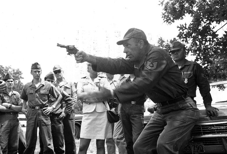 Airmen complete training during the training encampment June 16-17, 1956 at Camp Williams (now Volk Field), Wis.