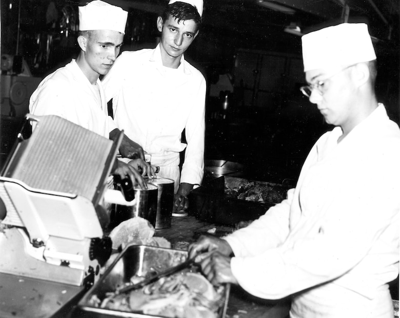 Cooks prepare a meal at Camp Williams, Wis. during summer training encampment June 16-17, 1956.