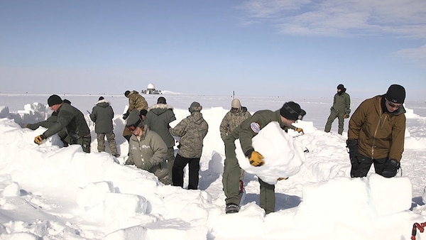 """Students build a shelter during barren land arctic survival training, commonly known as """"Kool School"""" on June 9, 2018 at Raven Camp, Greenland. This year, 25 Airmen from the New York Air National Guard's 109th Airlift Wing in Scotia, New York, completed the training, learning basic arctic survival skills."""