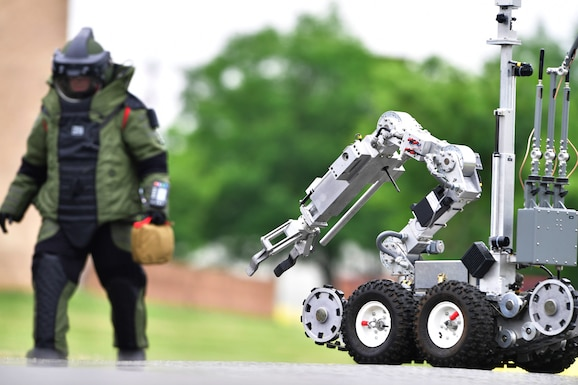 An F6 robot is used to investigate a suspicious package during a training event at New Castle Air National Guard Base, Del., June 21, 2018. The training provided an opportunity to train and execute emergency response procedures in the event a suspicious package were reported on base. (U.S. Air National Guard photo by Staff Sgt. John Michaels)