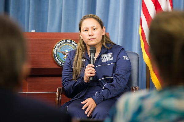 Navy Master Chief Petty Officer Reina Hockenberry addresses media at the Pentagon, June 20, 2018. Hockenberry shared her experiences as a competitor in the 2018 Department of Defense Warrior Games, and of her return to active duty after recovering from wounds sustained in Afghanistan. DoD photo by Army Staff Sgt. Vito T. Bryant