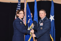 U.S. Air Force Maj. Gen. Mary O'Brian, 25th Air Force commander, hands the 480th Intelligence, Surveillance and Reconnaissance Wing guidion to the wing's new commander, Col. Max Pearson, during a change of command ceremony June 19, 2018, at Joint Base Langley-Eustis, Virginia.