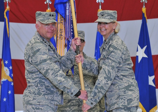 U.S. Air Force Col. Jennifer Reeves, right, accepts command of the 341st Missile Wing from Maj. Gen. Fred Stoss, 20th Air Force commander, as Chief Master Sgt. Amber Mitchell, 341st MW guidon bearer, looks on during a change of command ceremony at Malmstrom Air Force Base, Mont., June 19, 2018. Reeves' previous assignment was 381st Training Group commander, Air Education and Training Command, at Vandenberg AFB, Calif. The 341st Missile Wing, headquartered at Malmstrom AFB, is one of three U.S. Air Force bases that maintains and operates the Minuteman III intercontinental ballistic missile. (U.S. Air Force photo by John Turner)
