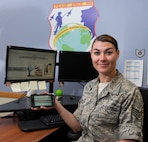 Staff Sgt. Brittany G. Bigelow, a personnelist assigned to the 157th Maintenance Group, poses for a portrait on June 19, 2018 at Pease Air National Guard Base, N.H.  Bigelow has worked to bring the Lodging Force application to the Wing, to improve the process of booking hotel accommodations for airmen who are in a duty status, saving working hours and funds. (N.H. Air National Guard photo by Staff Sgt. Kayla White)