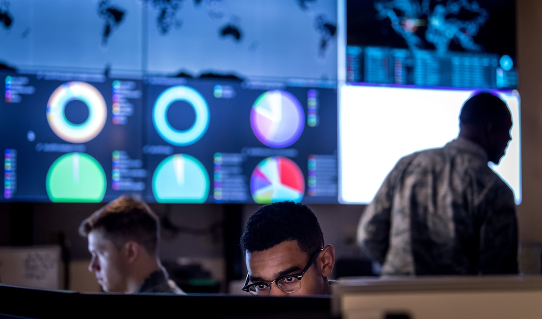 Cyber warfare operators assigned to the 275th Cyber Operations Squadron of the Maryland Air National Guard's 175th Cyberspace Operations Group configure a threat intelligence feed for daily watch in the Hunter's Den at Warfield Air National Guard Base, Middle River, Md.