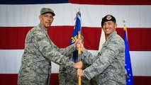 Col. Kevin Mantovani, 51st Mission Support Group commander, left, presents the guidon to Maj. Stephen Addington, 51st Security Forces Squadron commander, during a change of command at Osan Air Base, Republic of Korea, June 22, 2018.
