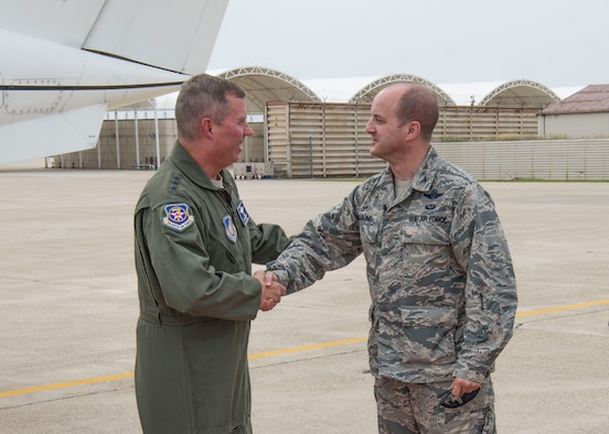 Col. John Bosone, 8th Fighter Wing commander, greets Lt. Gen. Thomas Bergeson, 7th Air Force commander, after arriving at Kunsan Air Base, Republic of Korea, June 22, 2018. During the visit Bergeson met with Wolf Pack leadership and visited Airmen. (U.S. Air Force photo by Tech. Sgt. Charles McNamara)