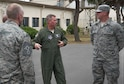 Lt. Gen. Thomas Bergeson, 7th Air Force commander, speaks with Senior Airman Alexander Wing, a vehicle operator from the 8th Logistics Readiness Squadron, during a visit at Kunsan Air Base, Republic of Korea, June 22, 2018. While at Kunsan, Bergeson visited Airmen and met with Wolf Pack leadership from across the base. (U.S. Air Force photo by Tech. Sgt. Charles McNamara)