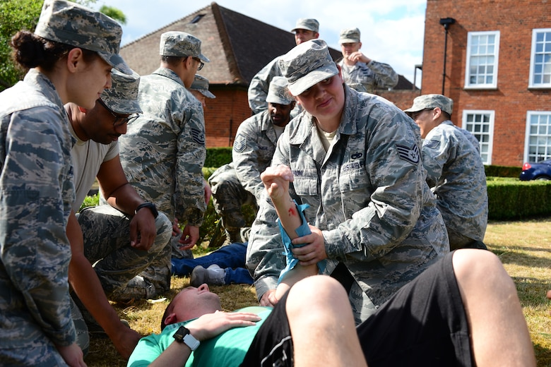 U.S. Airmen perform first aid to simulated injured bystanders during an exercise at RAF Mildenhall, England, June 20, 2018. The exercise tested the responsiveness and readiness of base personnel. (U.S. Air National Guard photo by Tech. Sgt. Daniel Gagnon)