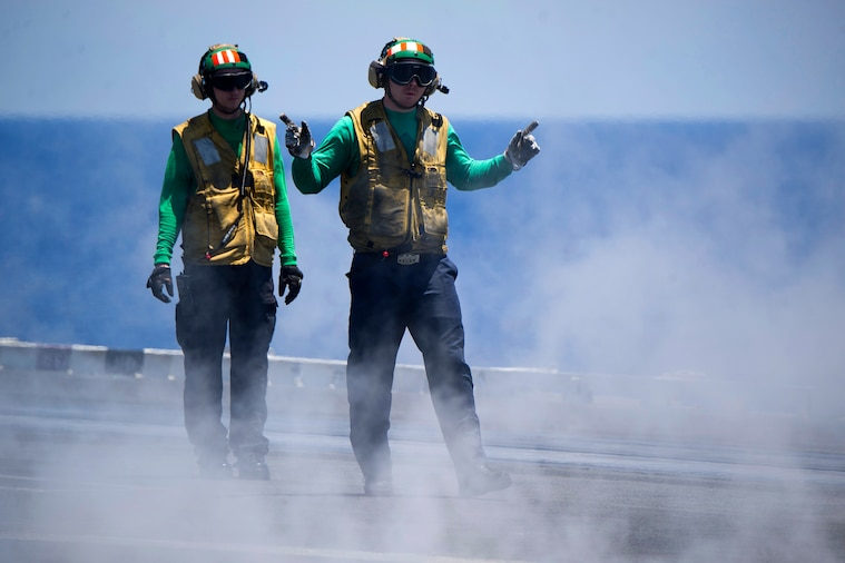 Sailors conduct flight deck operation aboard the aircraft carrier USS Harry S. Truman in the Mediterranean Sea, June 14, 2018. Navy photo by Petty Officer 3rd Class Rebekah A. Watkins