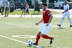 Marine Corps Gunnery Sgt. Alberto Boy competes for the first time at the Armed Forces Men's Soccer Championship at Fort Bragg, N.C.