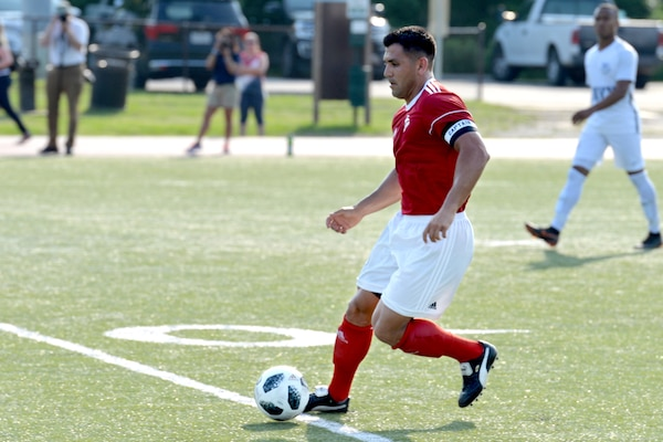 Marine Corps Gunnery Sgt. Alberto Boy competes for the first time at the Armed Forces Men's Soccer Championship at Fort Bragg, N.C., June 3, 2018. Navy photo by Lt. Dana Ayers