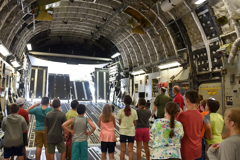 Children of North Carolina (NC) Air National Guardsmen watch the doors open and close while touring a C-17 Globemaster III aircraft held at the NC Air National Guard Base, Charlotte-Douglas International Airport, June 18, 2018. The children are part of the annual Department of Defense STARBASE summer camp program and learn various applications of science, technology, engineering, and math.