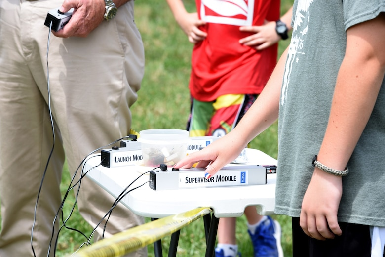 Mark Odell, son of U.S. Air Force Senior Airman Frank Odell, vehicle operator with the 145th Logistics Readiness Squadron, launches his model rocket near Reid Park Academy Charlotte, N.C., June 21, 2018. Odell, along with other campers and teachers are part of the annual Department of Defense STARBASE summer camp program with the North Carolina Air National Guard and they learn various applications of science, technology, engineering, and math.