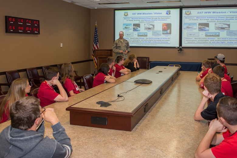 U.S. Air Force Master Sgt. Jeff Williams, 557th Weather Wing wing inspection team manager, gives students from the University of Nebraska-Lincoln Weather Camp a weather wing mission brief June 12, 2018, Offutt Air Force Base, Nebraska. The campers toured the building and learned about career opportunities in Air Force Weather. (U.S. Air Force photo by Paul Shirk)