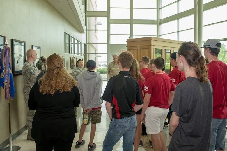U.S. Air Force Maj. Brian Miller, 557th Weather Wing (WW) commander's action group chief, describes opportunities in Air Force Weather to students from the University of Nebraska-Lincoln Weather Camp during a tour of the 557th WW June 12, 2018, Offutt Air Force Base, Nebraska. Students also viewed the wing's historical artifacts before touring the wing's Space Weather Operations Center and High Performance Computer Center. (U.S. Air Force photo by Paul Shirk)