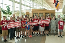 Students from the University of Nebraska-Lincoln Weather Camp pose for a group photo with 557th Weather Wing staff in the wing's atrium June 12, 2018, Offutt Air Force Base, Nebraska. The students visited the wing as part of a career camp for high school students interested in meteorology. (U.S. Air Force photo by Paul Shirk)