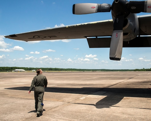 Flight engineer student inspects a C-130H assigned to the 189th Airlift Wing.
