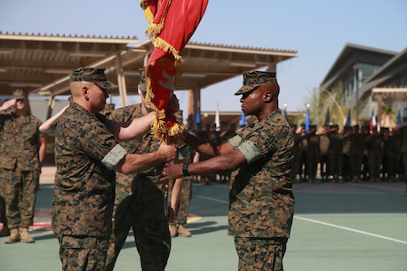 Lt. Col. Barian Woodward, off-going commanding officer, Communication Training Battalion, Marine Corps Communication-Electronics School, passes the battalion colors to Lt. Col. Russell Savatt, on-coming commanding officer, CTB, MCCES, at a change-of-command ceremony aboard the Marine Corps Air Ground Combat Center, Twentynine Palms, Calif., June 13, 2018. (U.S. Marine Corps photo by Lance Cpl. Preston L. Morris)