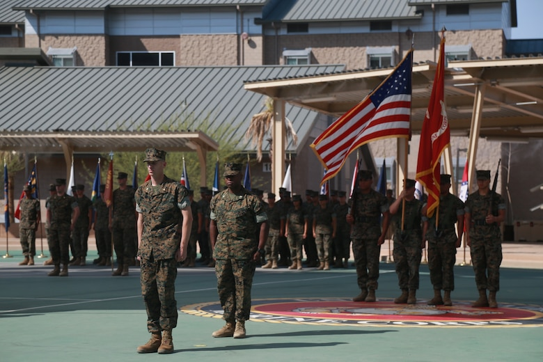 Lt. Col. Barian Woodward, off-going commanding officer, Communication Training Battalion, Marine Corps Communication-Electronics School, stands before the colors during a change-of-command ceremony aboard the Marine Corps Air Ground Combat Center, Twentynine Palms, Calif., June 13, 2018. During the ceremony, Woodward relinquished command of the battalion to Lt. Col. Russell Savatt. (U.S. Marine Corps photo by Lance Cpl. Preston L. Morris)