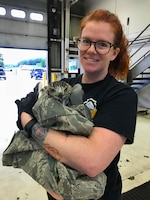 Staff Sgt. Rachel E. Marsan, an aerospace ground equipment mechanic assigned to the 157th Maintenance Group, poses for a portrait on June 18, 2018 at Pease Air National Guard Base, N.H. Marsan rescued the hawk after it had gotten its head stuck between the railings of a B-7 work stand. (Courtesy photo from Staff Sgt. Rachel E. Marsan)