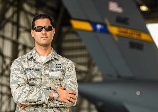 Capt. Elie Elchartouni, 437th Maintenance Flight officer in charge, poses for a portrait inside a hangar on Joint Base Charleston, S.C. June 6, 2018. Elchartouni immigrated to America from Lebanon when he was 18 years old and joined the Air Force to give back to his country.