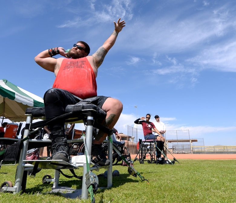Michael Wishnia, Paralympic shotputter and Marine Corps veteran, prepares to throw a shotput during training at Luke Air Force Base, Ariz., June 13, 2018. As part of a partnership between the Department of Defense and the International Paralympic Committee, adaptive athletes and Paralympic prospects can utilize sports and medical facilities at military bases to prepare for competitions. (U.S. Air Force photo by Senior Airman Ridge Shan)