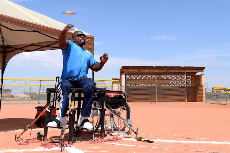 An adaptive athlete and Paralympic prospect throws a discus during training at Luke Air Force Base, Ariz., June 13, 2018. Several athletes stayed at Luke to train for the Desert Challenge adaptive sports competition at Arizona State University June 15-16. (U.S. Air Force photo by Senior Airman Ridge Shan)